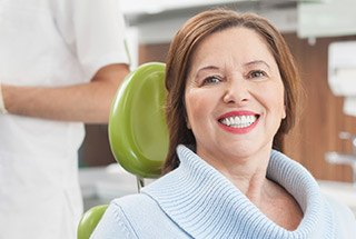 Senior woman smiling in dental chair