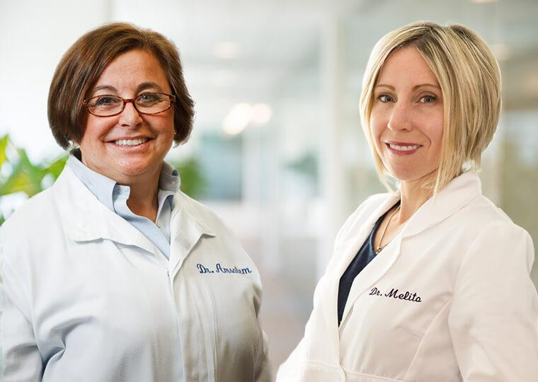 Headshots of periodontist Dr. Amsalem and endodontist Dr. Melita