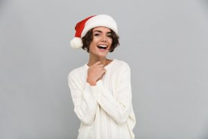 woman wearing Santa hat and smiling