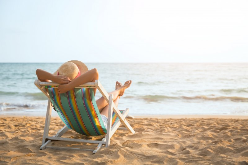 woman relaxing on the beach during summer vacation
